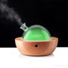 Bild von YUN Aromavernebler mit hochwertigem Eiche Gehäuse und mundgeblasener Glashaube.